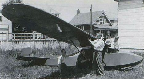 Young Russ Norman (under the strut) works on the Kirby Cadet glider, CF-ZBA. NORMAN COLLECTION
