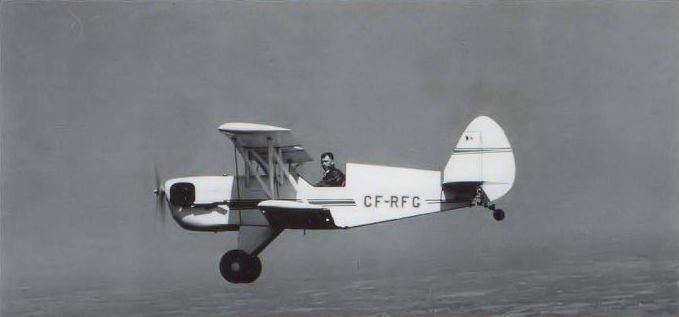 Russ Norman brings his EAA Biplane, CF-RFG, in tight for the capable camera of the author's late father. J. McNULTY.